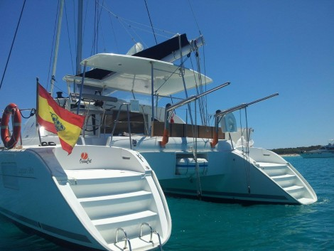 catamaran stern at anchor in Ibiza